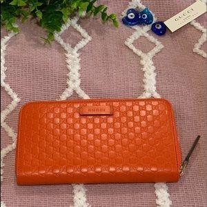 {Gucci} signature zip around leather wallet